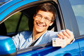 Guy shows driving license from car Royalty Free Stock Photo
