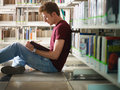 Guy studying in library Stock Photo