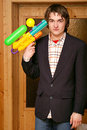 Guy with toy gun Royalty Free Stock Images
