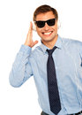 Guy wearing sunglasses and listening to music Royalty Free Stock Photography