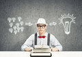 Guy writer young in hat and glasses using typing machine Royalty Free Stock Photography