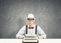 Guy writer young in hat and glasses using typing machine Stock Image