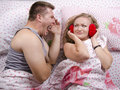 The guy is yelling at the girl lying in bed young couple was not looking like a fool top view Royalty Free Stock Image