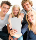 Guys and girls holding blank cards Stock Images