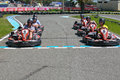 Guys having fun on a go cart start line malaga spain august people in karting circuit beach park august in costa del sol malaga Stock Photos