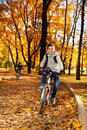 Guys riding bike in autumn park black happy years old boy a bicycle the Royalty Free Stock Image
