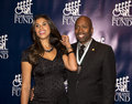 Gwendolyn osborne and kenny smith retired nba star arrive on the red carpet for the th annual great sports legends dinner to Royalty Free Stock Image