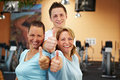 image photo : Gym employees holding thumbs up