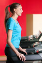 Gym exercising. Run on on a machine. Royalty Free Stock Photo