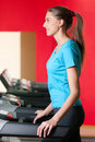 Gym exercising. Run on on a machine. Royalty Free Stock Photography