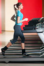 Gym exercising. Run on on a machine. Royalty Free Stock Photos