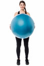 Gym girl presenting a swiss ball Stock Photos