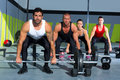 Gym group with weight lifting bar crossfit workout Royalty Free Stock Photos
