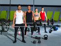 Gym group with weight lifting bar crossfit workout Stock Photos
