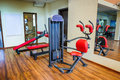 Gym interior abs machine and other equipment in Stock Image