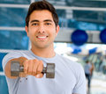 Gym man with free-weights Royalty Free Stock Images