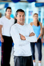 Gym man in front of a group Royalty Free Stock Photos