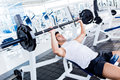 Gym man lifting weights Royalty Free Stock Photo