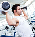 Gym man lifting weights Stock Photos