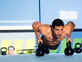 Gym man push-up strength pushup with Kettlebell Royalty Free Stock Image