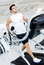 Gym man on the treadmill Stock Image