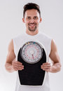 Gym man with a weight scale portrait of Royalty Free Stock Photography