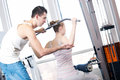 Gym man and woman doing exercise Royalty Free Stock Photos