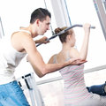 Gym man and woman doing exercise Royalty Free Stock Image
