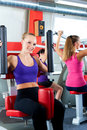 Gym people doing strength or fitness training Stock Photos