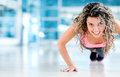 Gym woman doing push ups exercising at the Royalty Free Stock Images