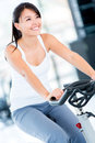 Gym woman doing spinning Stock Photography