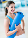 Gym woman holding yoga mat fit at the Stock Images