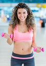 Gym woman lifting weights looking very happy Royalty Free Stock Photography