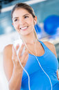 Gym woman listening to music Royalty Free Stock Photo