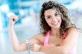Gym woman measuring her arm happy fit at the Stock Images