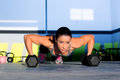 Gym woman push-up strength pushup with dumbbell Royalty Free Stock Photography
