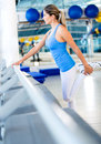 Gym woman stretching her leg Royalty Free Stock Photo