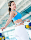 Gym woman taking measurements of her waist to ckeck her progress Royalty Free Stock Photo