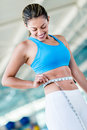 Gym woman taking measurements with a tape measure Royalty Free Stock Photos