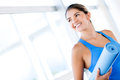 Gym woman with a yoga mat Royalty Free Stock Image