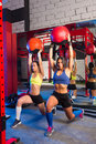 Gym women weighted ball workout exercise Royalty Free Stock Photo