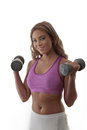 Gym workouts woman in clothes holding dumbbells doing a work out Stock Photography
