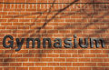 Gymnasium sign on brick wall in black letters red Stock Photography