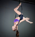 Gymnast beautiful woman performing aerial exercises Stock Photography
