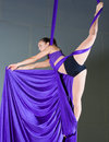 Gymnast beautiful woman performing aerial exercises Royalty Free Stock Photos
