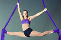 Gymnast beautiful woman performing aerial exercises Royalty Free Stock Image