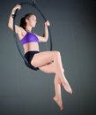 Gymnast beautiful woman performing aerial exercises Stock Photos