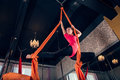Gymnast female performing aerial exercises Royalty Free Stock Images