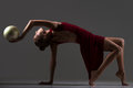 stock image of  Gymnast girl doing bridge exercise with ball