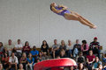 Gymnast girl jump flight vault spin jumping on the apparatus into a somersault during the competition age group at south african Royalty Free Stock Photography